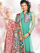 Let your personality articulate for you with this designer embroidery suit. The dazzling net kameez with satin inner having a beautiful floral embroidered work done with resham and grave embroidered border. Paired with matching heavy zari embroidered dupatta and churidar. Slight Color variations are possible due to differing screen and photograph resolutions.