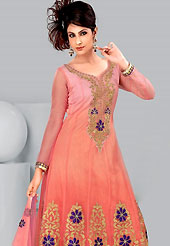 Be ready to slip in the comfort zone of this net suit. The dazzling kameez have amazing floral patch work on neckline and bottom area done with zari, stone, sequins and lace border. Matching embroidered dupatta and churidar is available. This drape material is net. The entire ensemble makes an excellent wear. Slight Color variations are possible due to differing screen and photograph resolutions.