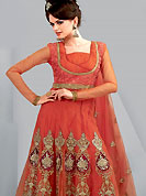 Era with extension in fashion, style, Grace and elegance have developed grand love affair with this ethnical wear. This Gorgeous red suit has long kameez which is designed with beautiful zari embroidered velvet patch work in floral patterns. This drape material is net. Matching churidar and embroidered dupatta is available. Slight color variations are possible due to differing screen and photograph resolutions.