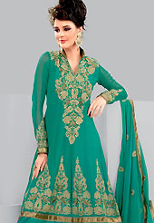 Take the fashion industry by storm in this lovely green churidar suit. The floral embroidery done with stone and zari work on kameez creates a stunning touch and adds to the elegance of the entire suit. This suit is made with georgette fabric. Matching dupatta and churidar gives a perfect finish to the entire suit. Slight Color variations are possible due to differing screen and photograph resolutions.