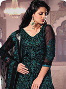 Breathtaking collection of designer suits with stylish embroidery work and fabulous style. This georgette suit has beautiful and fine embossed embroidered work on all over kameez and lace border with nice mixing of turquoise color gives a stylish look. Matching embroidered dupatta and churidar give you a classic look. Slight Color variations are possible due to differing screen and photograph resolutions.
