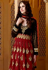 Exquisite combination of color, fabric can be seen here. This classic red and black suit with dupatta is motivating. This kameez is enhanced with neckline floral patch, lace border and butti work on all over kameez. All patterns are done with zari work. This suit is made with faux georgette fabric with brocade sleeves. Matching Churidar and dupatta made it attractive and exclusive to others. Slight Color variations are possible due to differing screen and photograph resolutions.