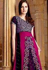 Motivate your look with this deep pink and purple suit. This suit adorns with amazing swirls pattern embroidery works on kameez. Beautiful rich embroidery on choli and front of kameez with border done with resham, sequins and zari work which is enhanced your personality. This drape material is faux georgette. Matching churidar and dupatta is available with this suit. Slight Color variations are possible due to differing screen and photograph resolutions.