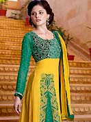 Motivate your look with this yellow and green suit. This suit adorns with amazing swirls pattern embroidery works on kameez. Beautiful rich embroidery on choli and front of kameez with border done with resham, sequins and zari work which is enhanced your personality. This drape material is faux georgette. Matching churidar and dupatta is available with this suit. Slight Color variations are possible due to differing screen and photograph resolutions.