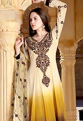 Breathtaking collection of designer suits with stylish embroidery work and fabulous style. This cream, yellow and brown shaded kameez has beautiful rich floral embroidered work on neckline with patch work on bottom area with lace border. Embroidered sleeves and dupatta gives a stylish look. Stylish neck is eye catching to impress all. This drape material is faux georgette. Matching dupatta and churidar is available with this suit. Slight Color variations are possible due to differing screen and photograph resolutions.