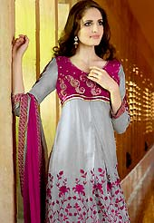 Era with extension in fashion, style, Grace and elegance have developed grand love affair with this ethnical wear. This Gorgeous grey and pink suit has long kameez which is designed with beautiful resham floral embroidered on bottom area with border patch and velvet choli. This drape material is faux georgette. Matching churidar and embroidered dupatta is available. Slight color variations are possible due to differing screen and photograph resolutions.