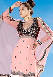 You can be sure that ethnic fashions selections of clothing are taken from the latest trend in today's fashion. This peach short kameez embellished with swirls patterned embroidered choli and border. Sleeves have also patch work.  Heavy embroidered patch worked sharara and dupatta is available with this drape. This drape material is shimmer georgette. Slight color variations are possible due to differing screen and photograph resolutions. Sleeves