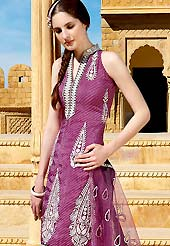 The popularity of this dress comes from the fact that it showcases the beauty modesty as well as exquisitely.  This suit has a wonderful paisley pattern embroidered patch worked kameez. This drape material is chiffon with leheriya printed inner. Matching churidar and embroidered net dupatta is available. Slight color variations are possible due to differing screen and photograph resolutions.
