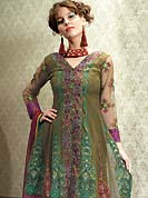 Dreamy variation on shape and forms compliment your style with tradition. The dazzling kameez have amazing rich embroidered floral patch work on all over done with zari and resham with lace border. This suit is made with net fabric. Matching embroidered dupatta and churidar is available with this suit. The entire ensemble makes an excellent wear and make you different to others. Slight Color variations are possible due to differing screen and photograph resolutions.