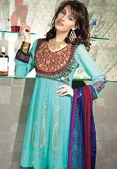 Be the rocker in the party by wearing this cool sky blue wear. The dazzling kameez have amazing rich embroidered floral patch work on all over done with zari and resham with lace border. This suit is made with faux georgette fabric. Matching embroidered dupatta and churidar is available with this suit. The entire ensemble makes an excellent wear and make you different to others. Slight Color variations are possible due to differing screen and photograph resolutions.