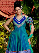 Breathtaking collection of suits with stylish embroidery work and fabulous style. The dazzling dual kameez pattern suit have amazing floral patch work on neckline done with zari, stone, sequins, resham and lace border. Stylish neck pattern is stunning and gives a pretty look. Matching embroidered dupatta and churidar is available. The entire ensemble makes an excellent wear. This suit is made with net fabric. Slight Color variations are possible due to differing screen and photograph resolutions.