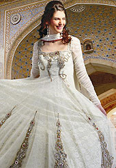 The popularity of this dress comes from the fact that it showcases the beauty modesty as well as exquisitely.  This anarkali suit has a wonderful embroidered kameez which is designed with urban floral patch work done with zari, reshams and sequins in bottom area. Stylish and beautiful pattern on choli is eye-catching and gives a pretty look. This drape material is net with inner. Matching churidar and embroidered dupatta is available. Slight color variations are possible due to differing screen and photograph resolutions.
