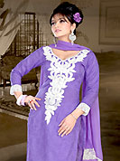 Look stunning rich with dark shades and floral patterns. This violet kameez has rick embroidered patch work on neckline done with resham and sequins work with kroshiya lace border on sleeves and bottom area. Self print work in floral motifs is nice. This suit is made with Georgette fabric. Matching Churidar and dupatta is available with this suit. Slight color variations are possible due to differing screen and photograph resolutions.