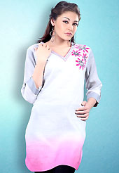 This White and Pink Readymade Indo Western Tunic. This tunic is nicely designed with floral embroidery work done with cotton thread. This is perfect casual wear readymade tunics. This is made with linen cotton fabric. Slight color variations are possible due to differing screen and photograph resolution.