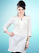 This White Readymade Indo Western Tunic. This tunic is nicely designed with floral embroidery work done with cotton thread. This is perfect casual wear readymade tunics. This is made with linen cotton fabric. Slight color variations are possible due to differing screen and photograph resolution.