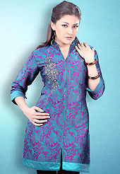 This Turquoise and Pink Readymade Indo Western Tunic. This tunic is nicely designed with floral embroidery work done with cotton thread. This is perfect casual wear readymade tunics. This is made with linen cotton fabric. Slight color variations are possible due to differing screen and photograph resolution.