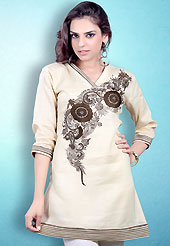 This Cream and Brown Readymade Indo Western Tunic. This tunic is nicely designed with floral embroidery work done with cotton thread. This is perfect casual wear readymade tunics. This is made with linen cotton fabric. Slight color variations are possible due to differing screen and photograph resolution.
