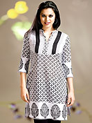 Welcome to the new era of Indian fashion wear.  A Stylish and beautiful floral print work on kurti creates a stunning touch and adds to the elegance of the entire suit. Stylish pattern of this kurti is nice. This kurti is made with cotton fabric. This is readymade casual wear and 36,38,40,42 & 44 sizes are available. Slight Color variations are possible due to differing screen and photograph resolutions.
