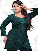 This turquoise green and black american crepe readymade tunic is nicely designed with floral and geometric print and patch work. This is a perfect casual wear readymade kurti. Bottom shown in the image is just for photography purpose. Minimum quantity order 12pcs in each style. Slight Color variations are possible due to differing screen and photograph resolutions.