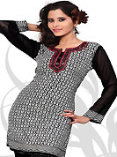 This black and white american crepe readymade tunic is nicely designed with floral, wave like print and resham embroidery patch work. This is a perfect casual wear readymade kurti. Bottom shown in the image is just for photography purpose. Minimum quantity order 12pcs in each style. Slight Color variations are possible due to differing screen and photograph resolutions.