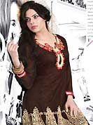 Attract all attentions with this embroidered kurti. This beautiful designer dark brown net readymade tunic have amazing embroidery patch work is done with resham work. The entire ensemble makes an excellent wear. This is a perfect patry wear readymade kurti. Accessories shown in the image is just for photography purpose. Slight Color variations are possible due to differing screen and photograph resolutions.