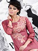Let your personality articulate for you with this amazing embroidered kurti. This beautiful designer dark onion pink georgette and brocade readymade tunic have amazing embroidery patch work is done with resham and lace work. The entire ensemble makes an excellent wear. This is a perfect patry wear readymade kurti. Accessories shown in the image is just for photography purpose. Slight Color variations are possible due to differing screen and photograph resolutions.