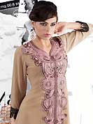 Style and trend will be at the peak of your beauty when you adorn this kurti. This beautiful designer dusty fawn georgette readymade tunic have amazing embroidery patch work is done with resham and crochet lace work. The entire ensemble makes an excellent wear. This is a perfect patry wear readymade kurti. Accessories shown in the image is just for photography purpose. Slight Color variations are possible due to differing screen and photograph resolutions.