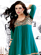 This season dazzle and shine in pure colors. This beautiful designer turquoise green georgette readymade tunic have amazing embroidery patch work is done with resham, zari and lace work. The entire ensemble makes an excellent wear. This is a perfect patry wear readymade kurti. Accessories shown in the image is just for photography purpose. Slight Color variations are possible due to differing screen and photograph resolutions.