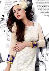 Look stunning rich with dark shades and floral patterns. This beautiful designer white net and georgette readymade tunic have amazing embroidery patch work is done with resham work. The entire ensemble makes an excellent wear. This is a perfect patry wear readymade kurti. Bottom and accessories shown in the image is just for photography purpose. Slight Color variations are possible due to differing screen and photograph resolutions.